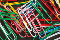 Paper clips on a black background Stock Images