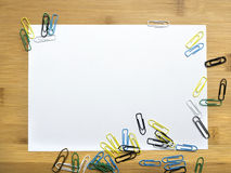 Paper clips and blank paper Royalty Free Stock Photo