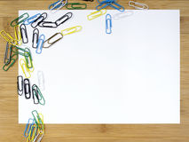 Paper clips and blank paper Stock Photo