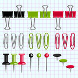 Paper clips and buttons on the notebook sheet Stock Photos