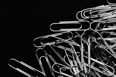 Paper clips closeup stationery on black clolor background Stock Photo