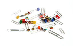 Paper clips and drawing pins many colors. Paper clips and drawing pins thumb tacks in many colors isolated on white background Royalty Free Stock Image
