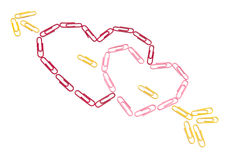 Paper clips hearts. On the isolated background Royalty Free Stock Image