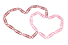 Paper clips hearts. On the isolated background Stock Images