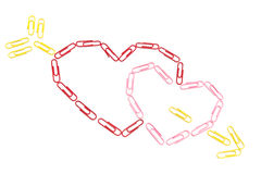 Paper clips hearts. On the isolated background Royalty Free Stock Photos