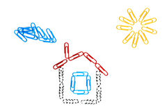 Paper clips house. On the isolated background Royalty Free Stock Image