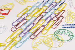 Paper clips isolated. Colourful multi-shaped paper clips isolated on white background Stock Photo