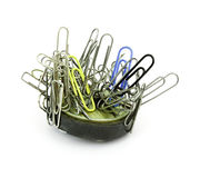 Paper clips and magnet Stock Images
