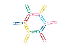 Paper clips. Multi-colored paper clips in the form of the sun isolated on a white background Royalty Free Stock Photos