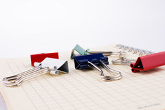 Paper Clips and notebook Stock Images