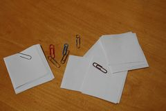 Paper clips and notes on a desk royalty free stock images