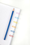 Paper clips and pencil. On white background stock photo