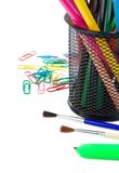 Paper clips and pencil in holder on white Royalty Free Stock Images