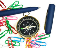 Paper clips, pens, compass on white background Stock Photo
