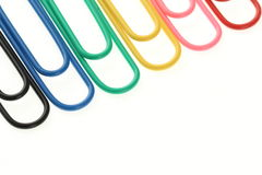 Paper clips rainbow. Paper clips background multicolour rainbow stock photography