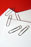Paper clips with a red background, Royalty Free Stock Images