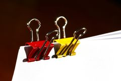 Paper clips in red and yellow Stock Photos