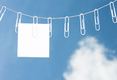 Paper Clips on a rope with a note Stock Image