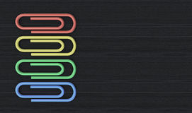 Paper clips. Top view of a set of colorful paper clips on wood background (3d render Stock Photos