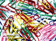 Paper Clips on a white backgroun. Paper clips are used to connect different documents Royalty Free Stock Photography