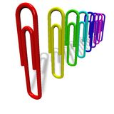 Paper clips on a white background. Stand vertically Stock Image