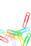 Paper clips on a white background Stock Photos