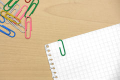 Paper clips on wood with grid papers Stock Photo
