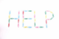 Paper clips word HELP Stock Images