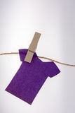 Paper clothes hang on a rope with clothespins Stock Photos