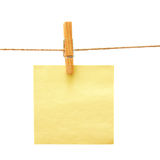 Paper with clothes peg over white Royalty Free Stock Images