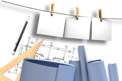 Paper on clothesline and architectural project Stock Image