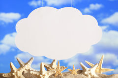 Paper cloud on sky background and beach Royalty Free Stock Photos