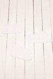 Paper cloud on white table. Paper cloud on white wooden table Stock Images