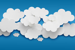 Paper Clouds. Abstract background composed of white paper clouds over blue royalty free stock image