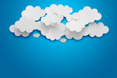 Paper Clouds. Abstract speech bubbles in the shape of clouds used in a social networks on light blue background. Cloud computing concept royalty free stock images