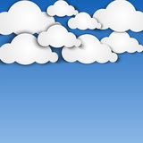 Paper clouds on blue background Royalty Free Stock Photo