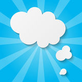 Paper clouds on blue background Royalty Free Stock Images