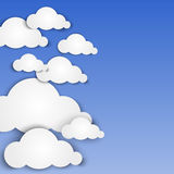 Paper clouds on blue background Royalty Free Stock Photos
