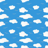 Paper clouds and gulls on blue sky Stock Images