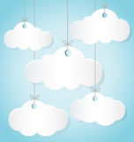 Paper Clouds Hanging The Ropes on Blue Background Stock Photos