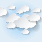 Paper clouds on light blue sky Royalty Free Stock Photos