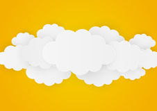 Paper clouds on orange Stock Photography