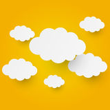 Paper clouds on orange background Royalty Free Stock Images