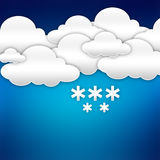 Paper clouds with snowflake over blue Stock Images
