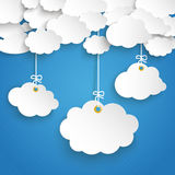 Paper Clouds Striped Blue Sky 3 Cloud Stickers. Paper clouds with 3 hanging cloud stickers on the blue background Stock Image