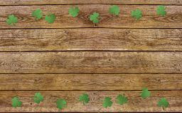 Paper clover leaves on the old wooden background. Lucky shamrock, St.Patrick`s day holiday symbol. Space for text, top view Royalty Free Stock Photography