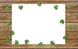 Paper clover leaves on the old wooden background. Lucky shamrock, St.Patrick`s day holiday symbol. Space for text, top view Royalty Free Stock Image
