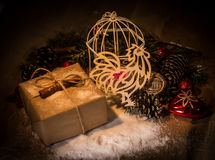 Paper Cockerel and box with gifts on Christmas background. Royalty Free Stock Photos