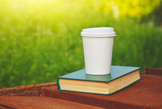 Paper coffee cup and book Stock Image