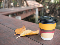 Paper coffee cup. Closeup paper coffee cup on wooden Royalty Free Stock Photography